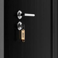 Brown hotel room door with key lable number 2019