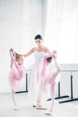 young ballet teacher training little ballerinas in ballet school