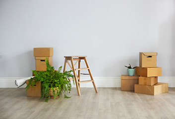 Cardboard boxes in empty new apartment