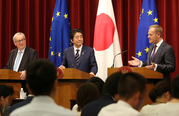 European Council President Donald Tusk speaks as Japanese Prime Minister Shinzo Abe and European Commission President Jean-Claude Juncker listen during a joint press conference of Japan -EU summit at Abe's official residence in Tokyo