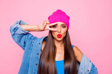 I am princess and number one here! Close up studio photo portrait of pretty lovely coquet charming excited lady making v-sign near eyes looking at you camera isolated bright color pastel background Wall mural