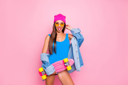 Happiness lifestyle leisure hobby skater people person concept. Photo portrait of beautiful funky attractive charming girl sticking tongue out holding longboard isolated bright background