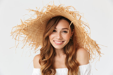 Portrait closeup of attractive charming woman 20s wearing big straw hat posing on camera with lovely smile, isolated over white background