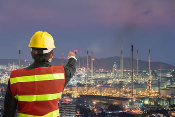 Petrochemical engineering man with white safety helmet standing