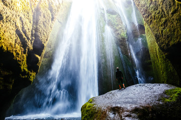 Perfect view of famous powerful Gljufrabui waterfall in sunlight.