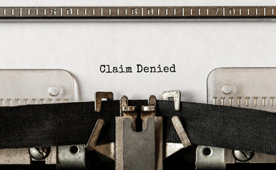 Text Claim Denied typed on retro typewriter