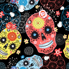 Seamless graphic pattern from cheerful ornamental skulls