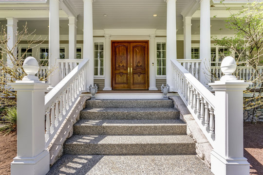 Entrance to a luxury country home with wrap-around deck.