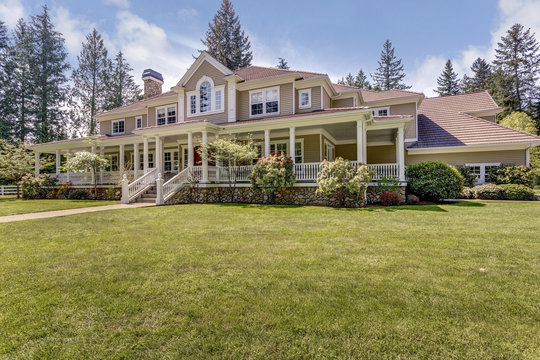 Large country home with wrap-around deck.