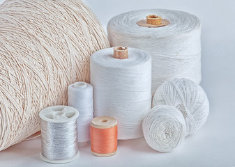 different types of white threads cotton, elastic band, flax, plait, mouline thread, silk