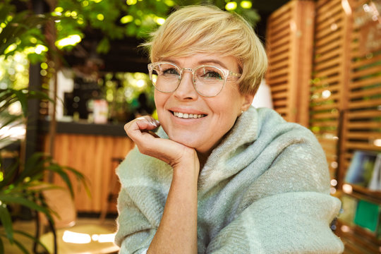 Joyful mature woman in eyeglasses
