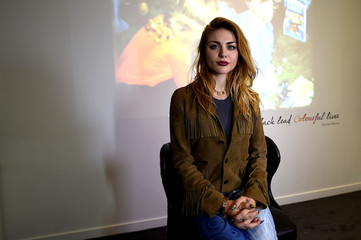 Kurt Cobain's daughter Frances Bean Cobain poses for a photograph in front of a home movie of Kurt at the opening of 'Growing Up Kurt' exhibition featuring personal items of Nirvana frontman Kurt Cobain at the museum of Style Icons in Newbridge