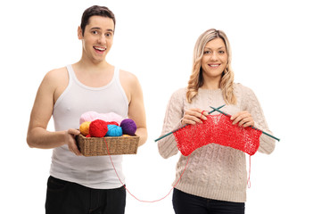 Young man and a young woman knitting together