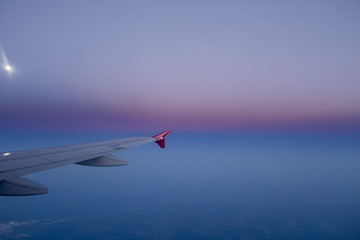 wing of an airplane in a beautiful night sky