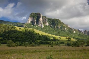 trascau mountains with piatra secuiului over the village of Rimetea - famous destination in Transylvania, Romania