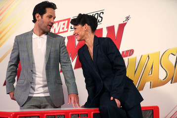 Actors Paul Rudd and Evangeline Lily pose for photos at the launch of the new Marvel Studios film 'Ant Man and The Wasp' in central London