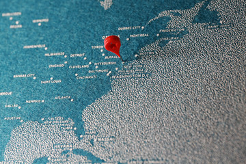 blue painted felt map with the pin