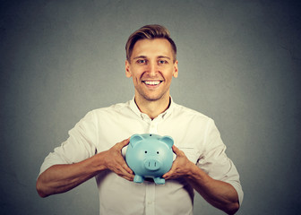 Happy man with blue piggy bank