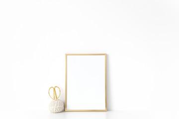Background for presentation , design, modern art, lettering. Template Empty Gold portrait frame mock up near white wall. Frame mockup