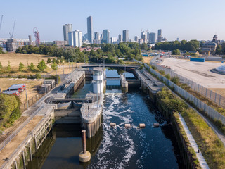 Lock on the canal with London Stratford cityscape in the background