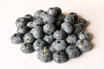 Fresh blueberries on a light background. Close up. The concept of natural food