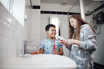 Siblings Brushing Their Teeth