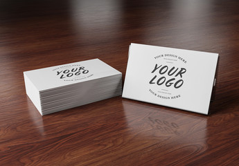 Stack of Business Cards on Wooden Desk Mockup