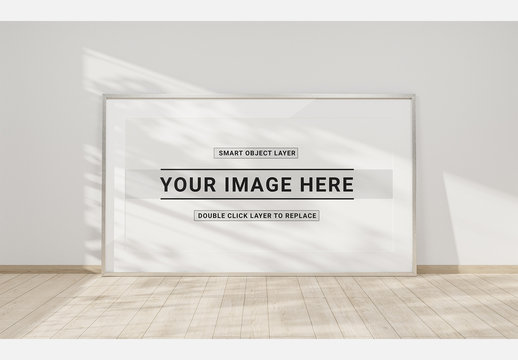 White Frame on Wooden Floor and a White Wall Mockup