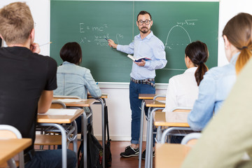 Teacher is giving lecture for students