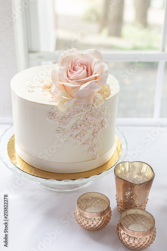 Elegant Wedding Cake With Edible Rose Topper And Lace Piping Design