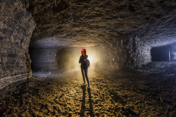 women stand in abandoned mine