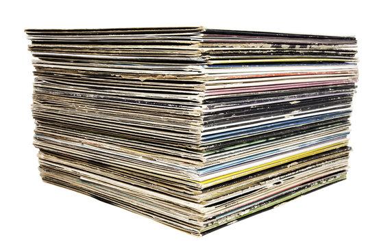 Stacked vintage vinyl record albums.