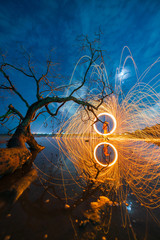 Fire steel wool long exposure with beautiful landscape