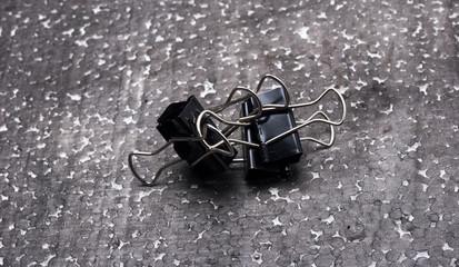 paper clips on dark background