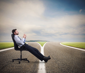 Difficult choices of a businessman at a crossroads. concept of confusion