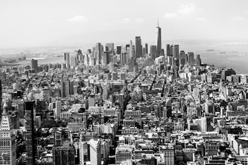 Wall Mural - Cityscape skyline of various buildings, skyscrapers and architecture looking down on midtown Manhattan in New York City towards downtowns Financial District in black and white