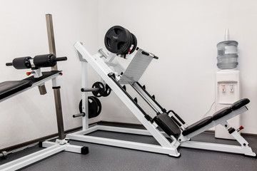 modern gym weight training equipment for exercises and rehab, leg presses. rehabilitation equipment in therapy clinic. fitness wellness concept. space for text