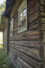 The old thrown, wooden house in the wood.