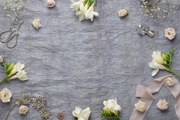 Styled photo - gray paper & flowers