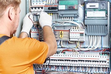 An electrical engineer checks the parameters of the electrical panel.