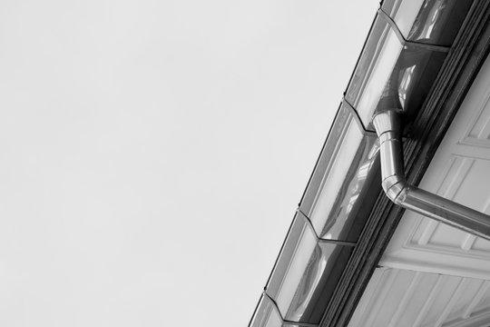 zinc rain gutter at the roof - monochrome
