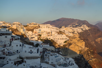 Whitewashed Houses on Cliffs with Sea View and Sunset in Oia, Santorini, Cyclades, Greece