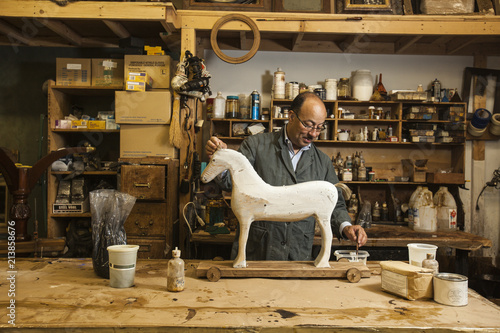 Business owner of antique restoration and wood carving
