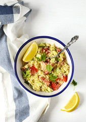 Lemon couscous. Couscous with tomato, cucamber, lemon and herbs. Traditional Arabic Salad Tabbouleh