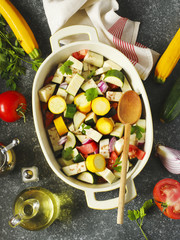 Fresh vegetables and cooking pan on table, top view. Healthy food and eating concept. Preparing for vegetable ragout.