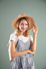 Beautiful young woman posing on color background. Summer fashion