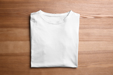 Blank t-shirt on wooden background