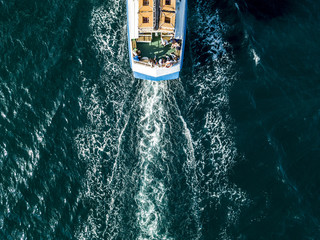 view from above of tourist cruise ship boat deck with passengers Wall mural
