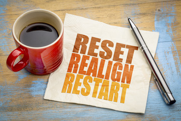 reset, realign, restart concept on napkin