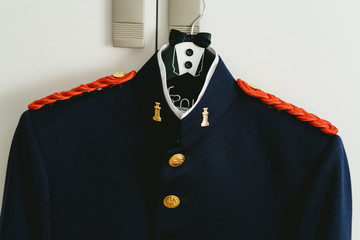 Military dress suit jacket hanging on a hanger